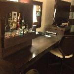 mini bar and office desk in the room