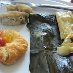 Dim Sum, tamales, with croissant at breakfast