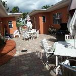 1 of 2 hotel courtyards with patio tables, bbq, etc.