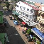 LOOKING DOWN FROM THE BALCONY TOWARDS THE LEFT, MEKONG RIVER AT THE FAR END.