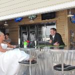Groom & Bride serving up drinks at The Landing - Clear Lake, IA