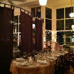 Dining room showing a cool divider seperating a private party