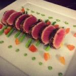 jasmine-tea-crusted tuna steak on roasted pineapple and thai asparagus in wasabi sauce