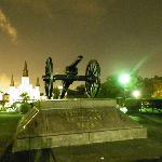 Washington Artillery Park cannon with Jackson Square and St. Louis Cathedral in the background