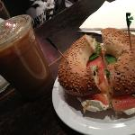 great sesame bagel toasted with cream cheese, tomato & basil