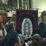 Mayan costumed dancers carry banners and dance to honor the Virgen on her feast day Dec. 12