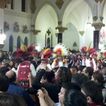 Mayan costumed dancers lead the way into Mass on la Virgen's feast day, Dec. 12, 2012