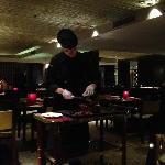 at one of their restaurants, the waitress cutting our peking duck