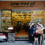 Staff of Com Pho Co in front of the restaurant