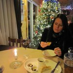 My wife enjoying the olive spread before the meal