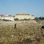 view of hotel from beach at low tide.