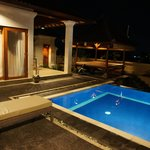 Swimming pool with patio in night view