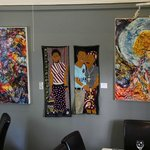 Walls covered with colourful art - Mateus Bistro