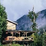 Refugio Cochamó (bed & breakfast) sits in the center of granite walls, waterfalls and native for