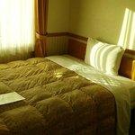シングルルーム(禁煙)のベッド