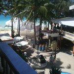 the beach; breakfast served at the 2nd floor balcony (right side of picture)