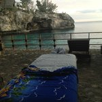 Sunset massage setup by the cave