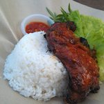 Nasi Ayam Penyet - rice served with local salad leaves (ulam) and pounded (penyet) BBQ chicken