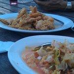 Butter prawns (dish in center), Umai Ikan (dish at bottom right)