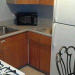 Our kitchen has a stove, microwave, fridge/freexer, sink, and a dinning table.