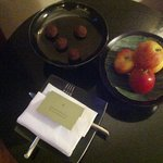 Complimentary dark chocolates and a plate of fruit