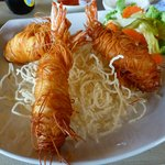 fried shrimps covered with noodles