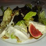 autumn green salad served with buffalo mozzarella, figs, and herbs