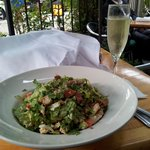 A glass of bubbly with my cobb salad.