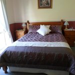 Bedroom in Merlot suite
