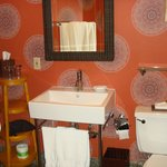 Mayan themed bathroom with amenities