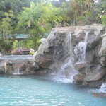 Jacuzzi (left of waterfall) and one of the waterfalls at Oasis swimming pool