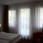 Superior double room with curtains on