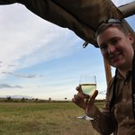Enjoying a sundowner while waiting for Leopard cubs