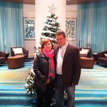 In front of the Christmas Tree in the lobby.