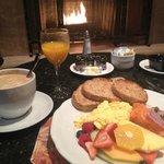 Canadian Salmon scrambled eggs, juice and Coffee breakfast.
