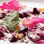 Beetroot ravioli with almond cheese filling and balsamic reduction