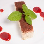 Coconut semi-freddo with strawberry coulis