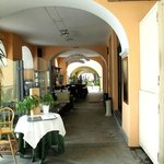 open-air trattoria under the arcades in Tremezzo