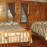 Two queen beds in the Wolf cabin