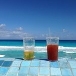Our drinks resting on the edge of infinity pool