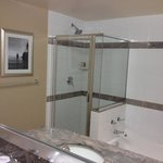 large, clean bathroom with separate tub and shower