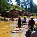 Rafting down the river past another mountain village