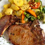Great pork chops with roast potatoes and veg