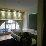 Lovely wrought iron arch in bedroom