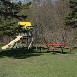 Swing set for the kids and plenty of play area.