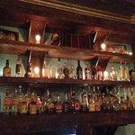 Bar shelves with assortment of spirits, aperitifs and digestifs highlighting Latin America