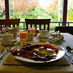 Enjoy breakfast in our large, sunny garden view dining room