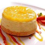 pineapple cheese cake with mango sauce