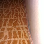 carpeted kick plate peeling from wall