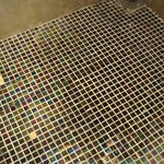 Missing mosaic tiles on shower floor - dangerous